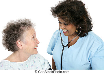 Caring Medical Professional - A caring nurse or doctor with...