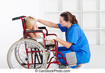 caring medical worker comforting little patient