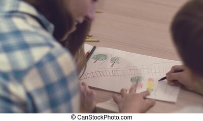 Caring Mom Helps Her Little Charming Son To Draw