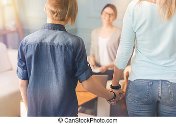 Caring mother and her son visiting a professional psychologist