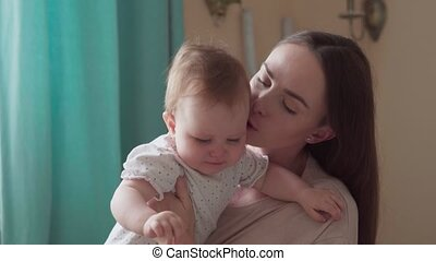 Caring mother calms her little crying child