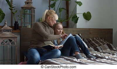 Caring mother helping her child with homework