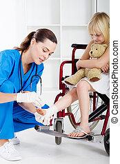 caring nurse bandage little girl