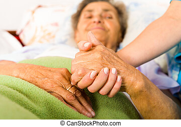 Caring Nurse Holding Hands