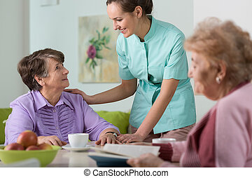 Caring nurse - Young pretty caring nurse and her two wards