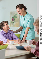 Caring nurse with the elderly
