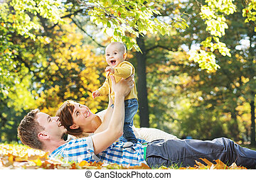 Caring parents looking after baby - Caring parents looking...