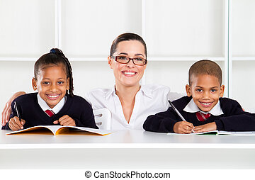 caring primary teacher and students