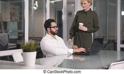 Caring Woman Brings Coffee to Colleague - Caring attractive...