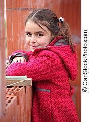 carino, piccola ragazza, il portare, uno, cappotto rosso