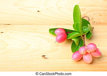 Carissa carandas fruits on wooden background