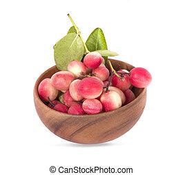 Carissa carandas Linn, Carunda , Karonda, Bengal currants , Karanda plum or Koromcha fruits in wooden bowl an isolated on white background