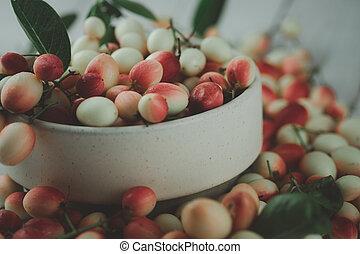 Carissa fruit in bowl