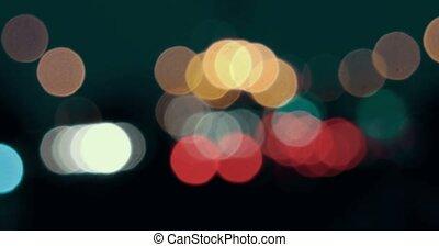 Carlights defocused. Blurred street lights in the night.
