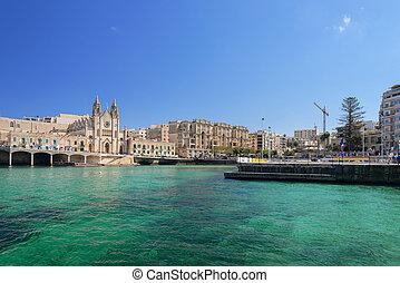 Neo-gothic Carmelite Parish Church and Balluta Buildings in Balluta Bay, St Julian's, Malta