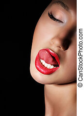 Carnality. Lust. Provocative Woman Licking her Red Sexy Lips. Passion