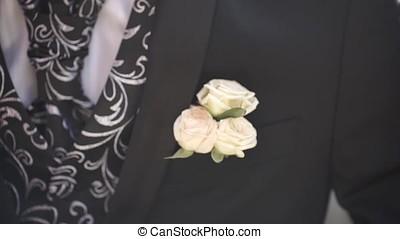 Carnation flower in a pocket. the flower in jacket pocket....