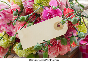 carnation flowers with blank tag