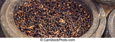 carnation grains, herbal medicinal herbs, dry carnation grains in a dish BANNER long format
