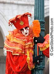 Carnevale di Venezia - Venetian mask and costume of red...