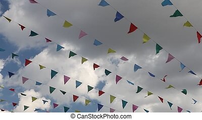 Carnival celebrate banner party flags against cloudy blue...