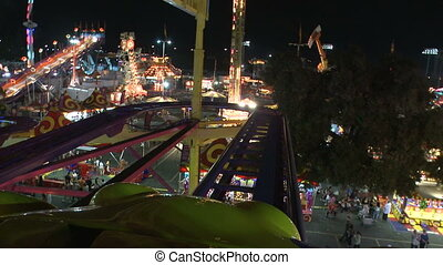Carnival crazy coaster - This is a fast motion, point of...
