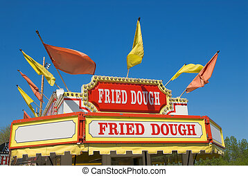 Carnival Fried dough Sign with a blue sky background