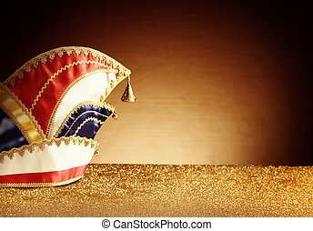 Carnival Hat Costume on Glittery Table