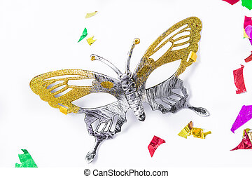 Carnival mask and colorful confetti on white background.