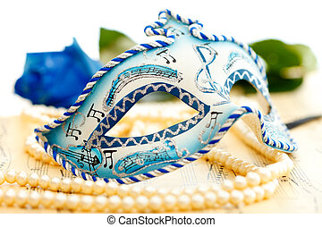 Carnival mask - Blue and white carnival mask on a music ...