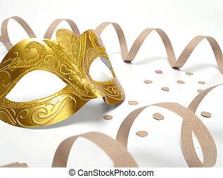Golden carnival mask on studio shot