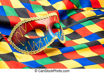 carnival mask on buffoon's disguise