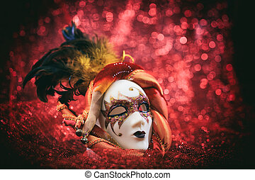 Carnival mask on red blur background