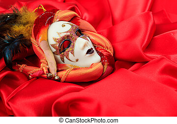 Carnival mask on red satin background