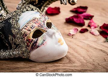 carnival mask on wooden background