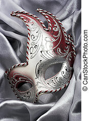 Carnival mask over gray satin