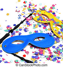 carnival masks and confetti of different colors