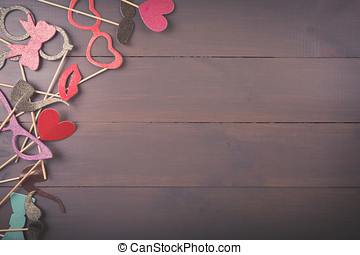 carnival party accessories on wooden background with copy space