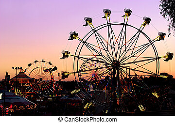 Carnival Ride - Silhouettes of carnival rides under sunset