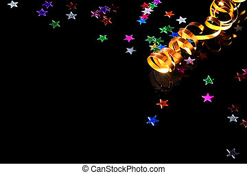 Carnival - Golden streamer and confetti on a black...