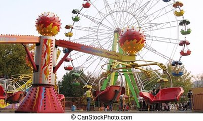 Carousel and Observation wheel are fly round in park Sokolniki