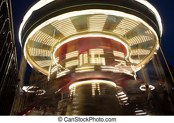 Carousel attraction in the night city.