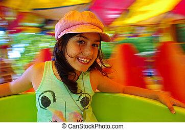 Carousel Fun - Little girl having fun in a carousel