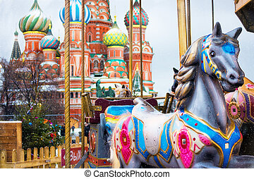 Carousel horses at the Christmas Fair on the background of...