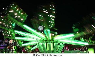 Carousel in amusement park at night