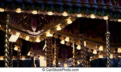 Carousel Lights In The Evening - Fairground ride at dusk...