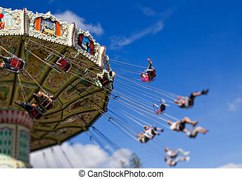 Photograph of a high speed carousel swing