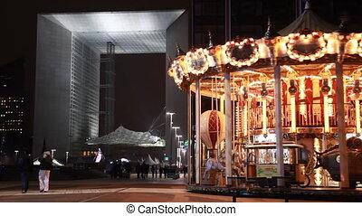 Carousel with illumination near Grand Arch of La Defense