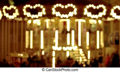 Carousel with lights shaped heart.