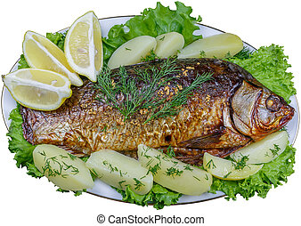 Carp cooked in the oven with potatoes and lemon